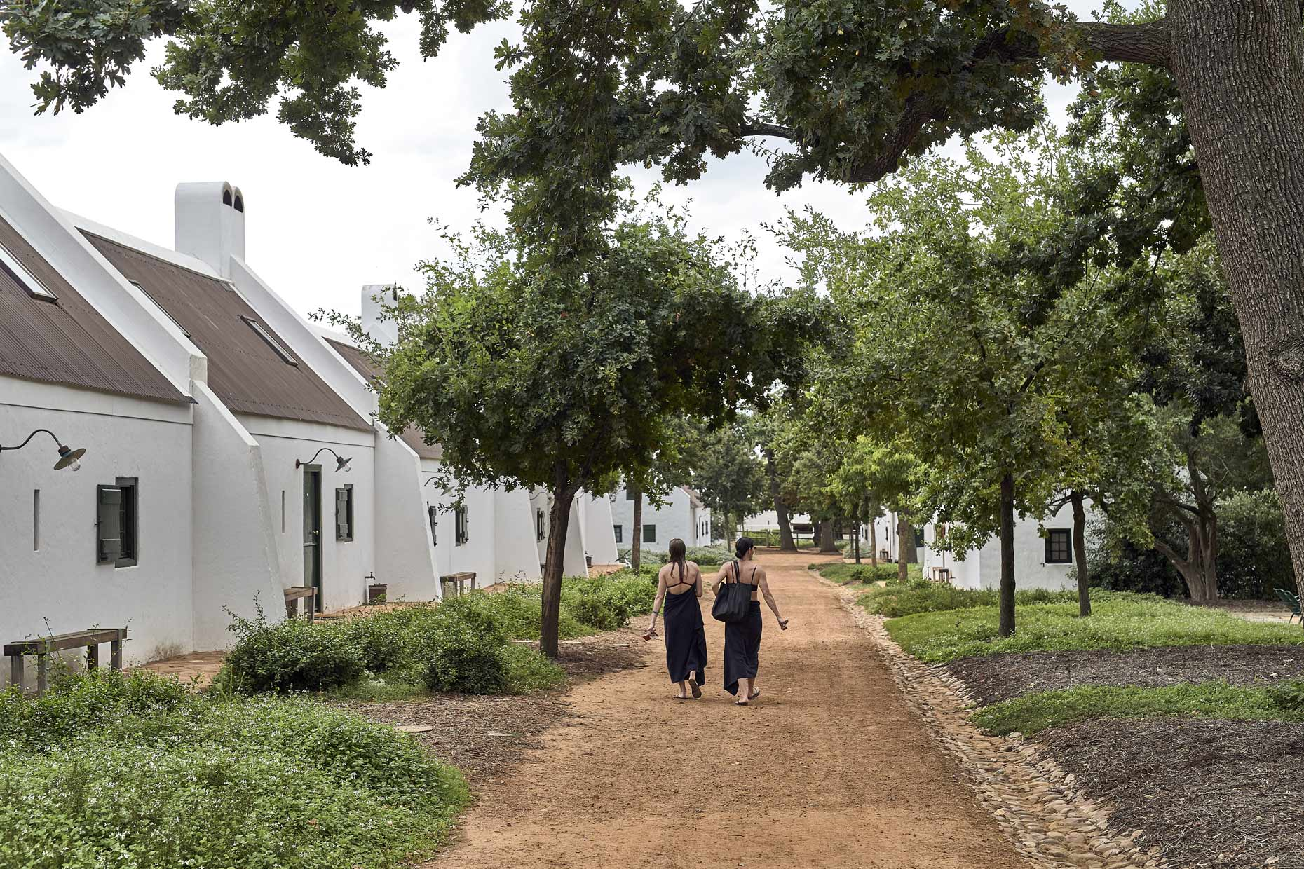 Babylonstoren-Two-Women-Walking-from-Pool