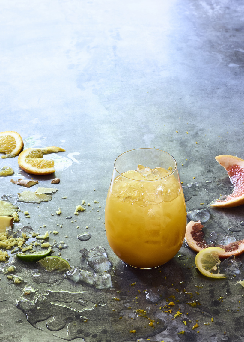 Citrus-Ginger-Zinger-juice-with-fruit-on-surface