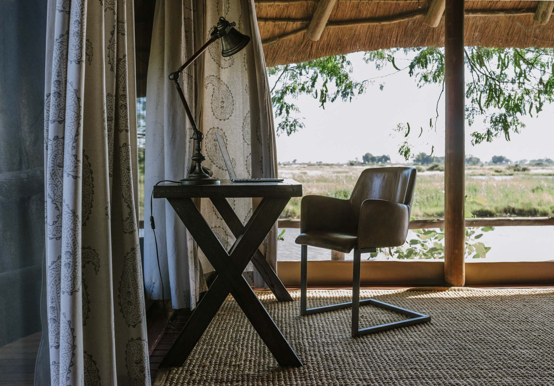 Cozy-table-and-chair-workspace-in-african-safari-house-YES