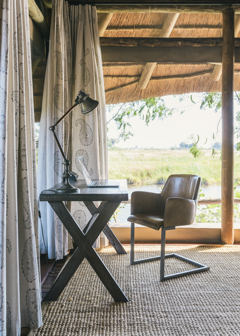 Cozy-table-and-chair-workspace-in-african-safari-house