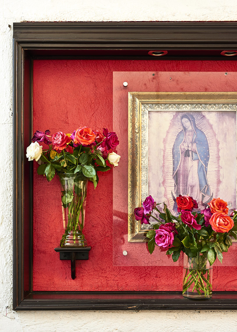 Framed-fresh-flowers-beside-Jesus