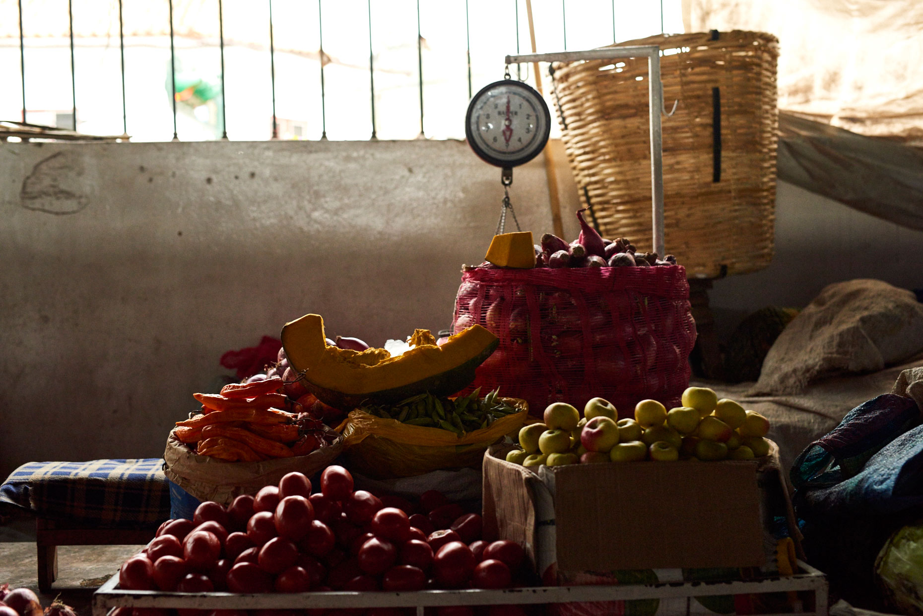 Fruit-and-vegetables-on-scale-at-Market-in-Cusco-Peru
