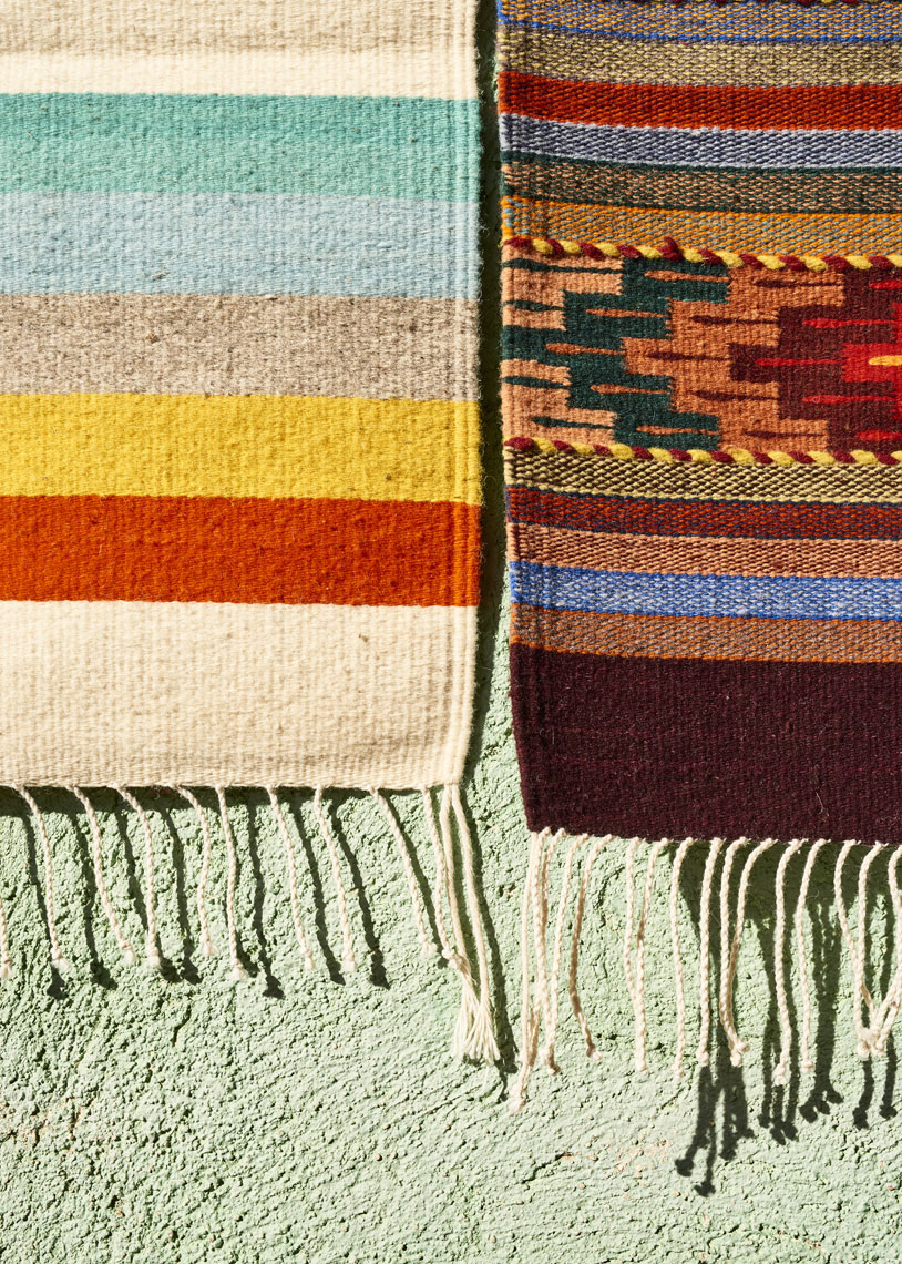 Handwoven-rugs-hanging-on-the-wall