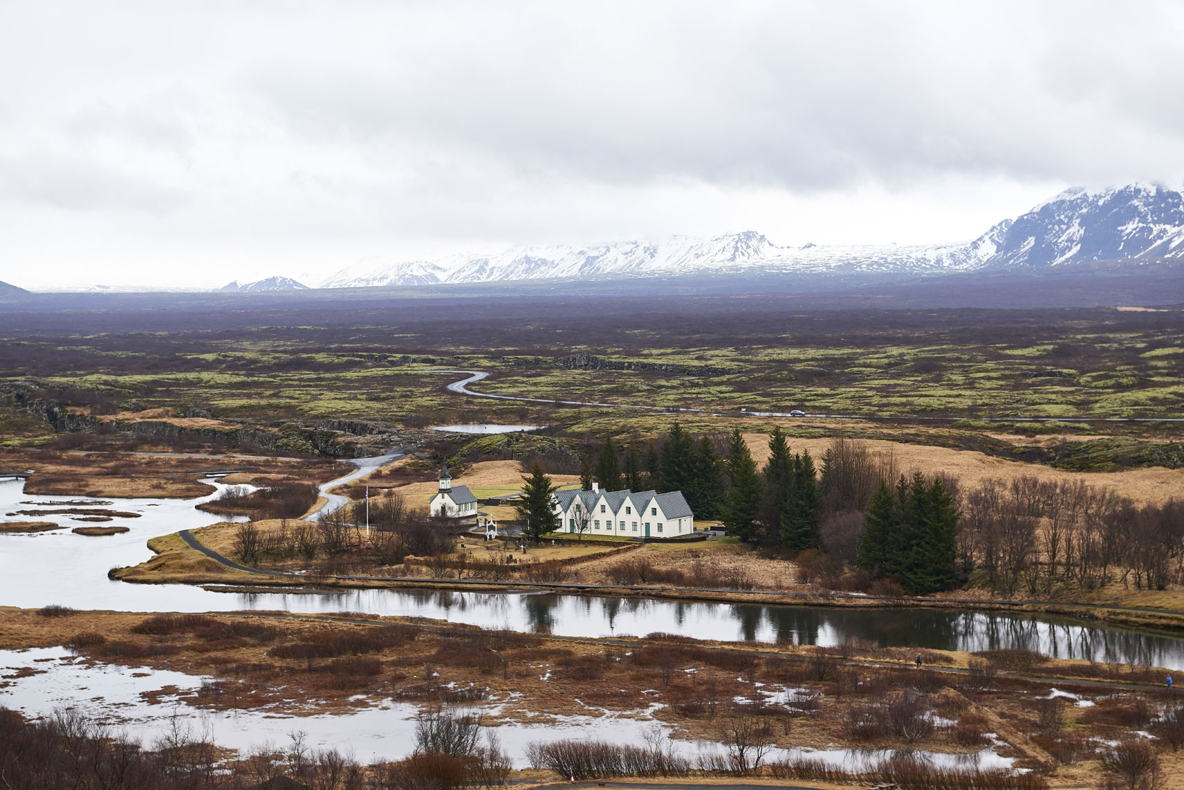 Large-Home-on-Riverway-against-Iceland-Mountains