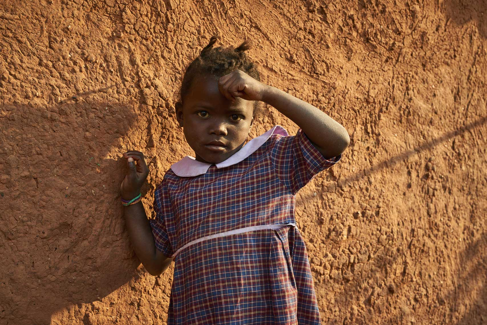 Little-Zambian-girl-posing-against-wall