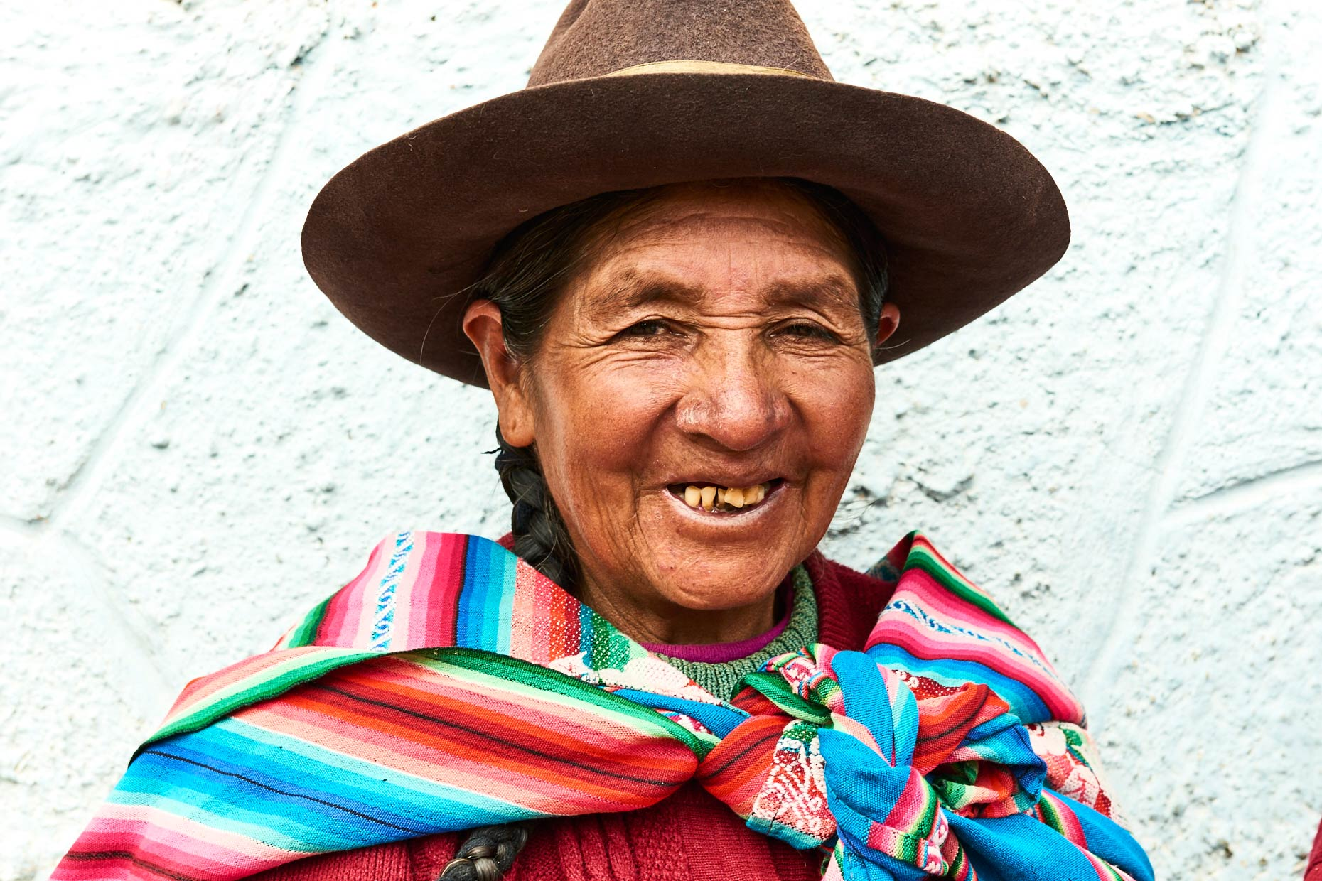 Local-Peruvian-woman-in-tall-hat-and-colorful-clothing-attire