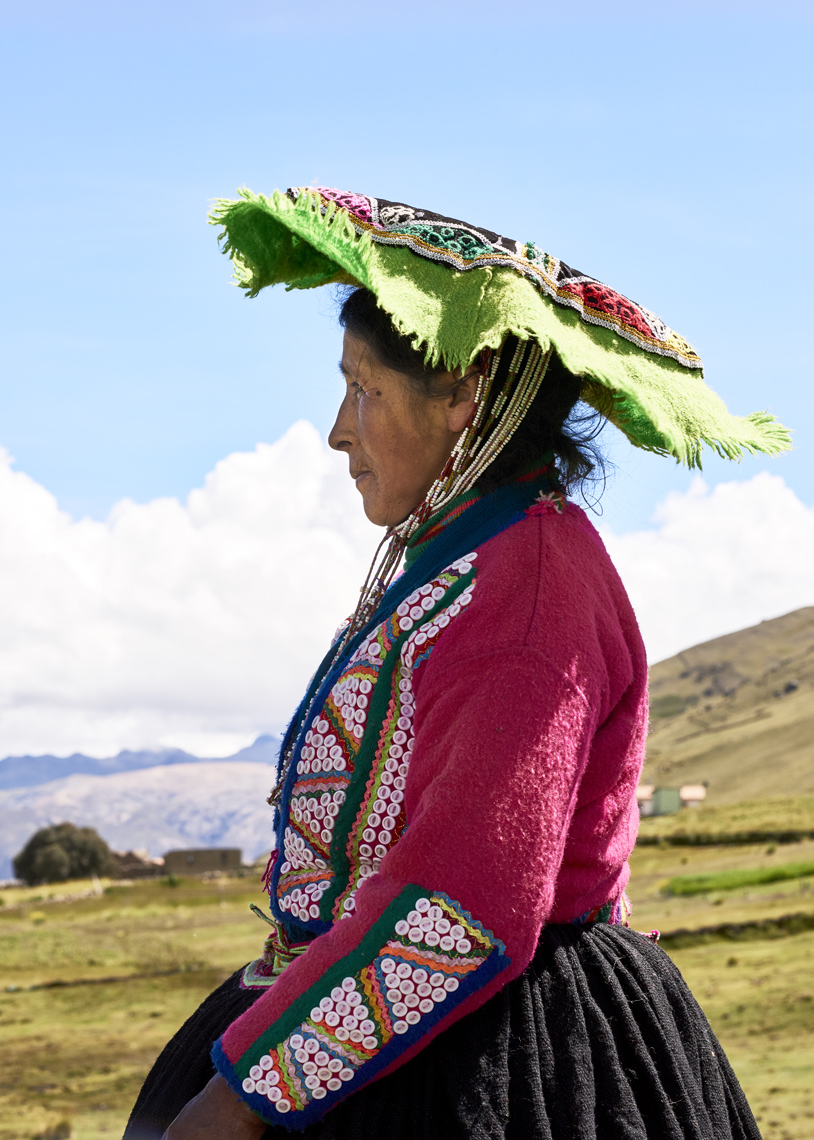 Local-Peruvian-woman-in-traditional-colorful-attire-gazes-into-far-away-distance-5x7