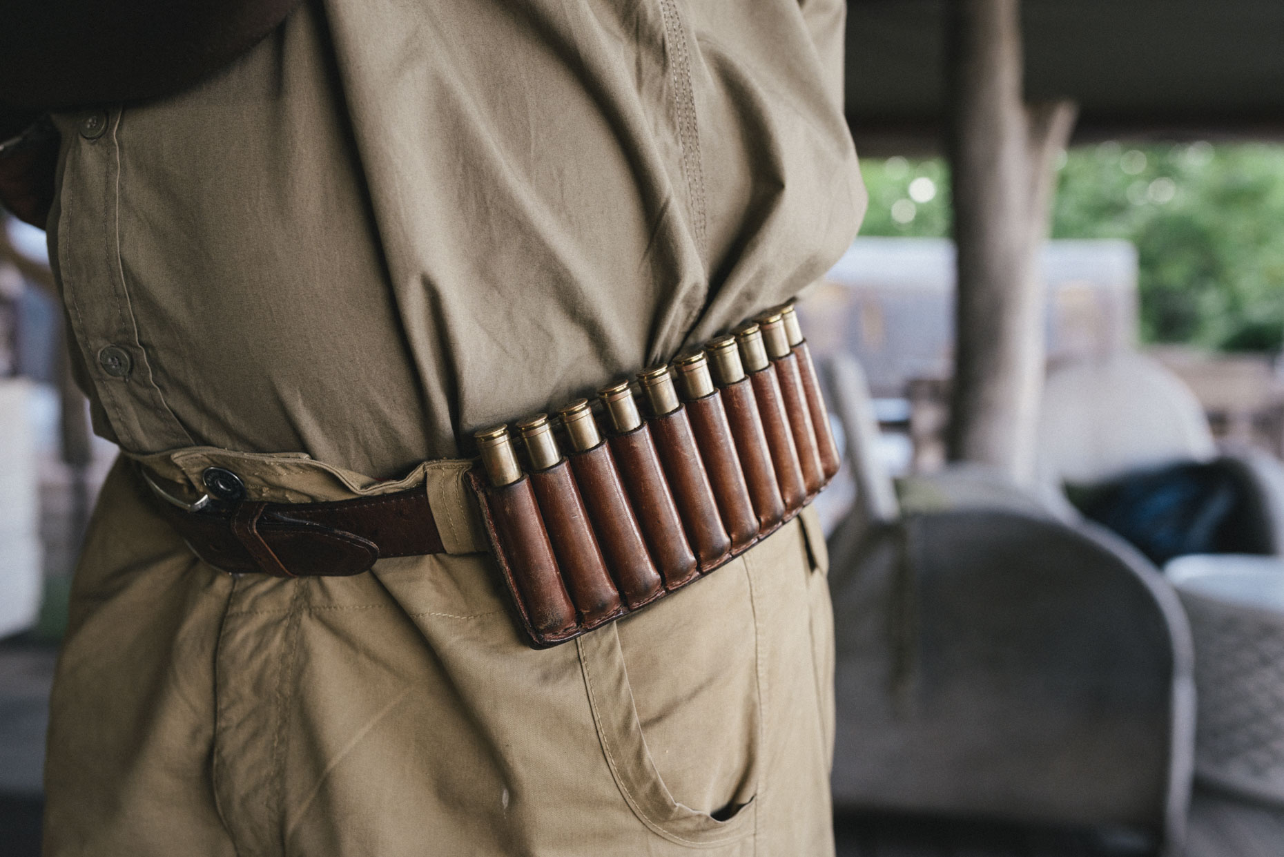 Man safari guide wearing belt with bullet cartridges