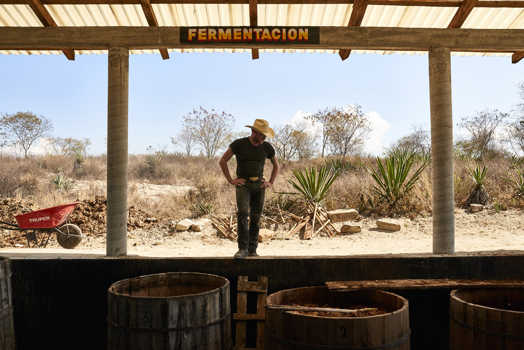 Mezcal-farmer-watching-fermentation-process