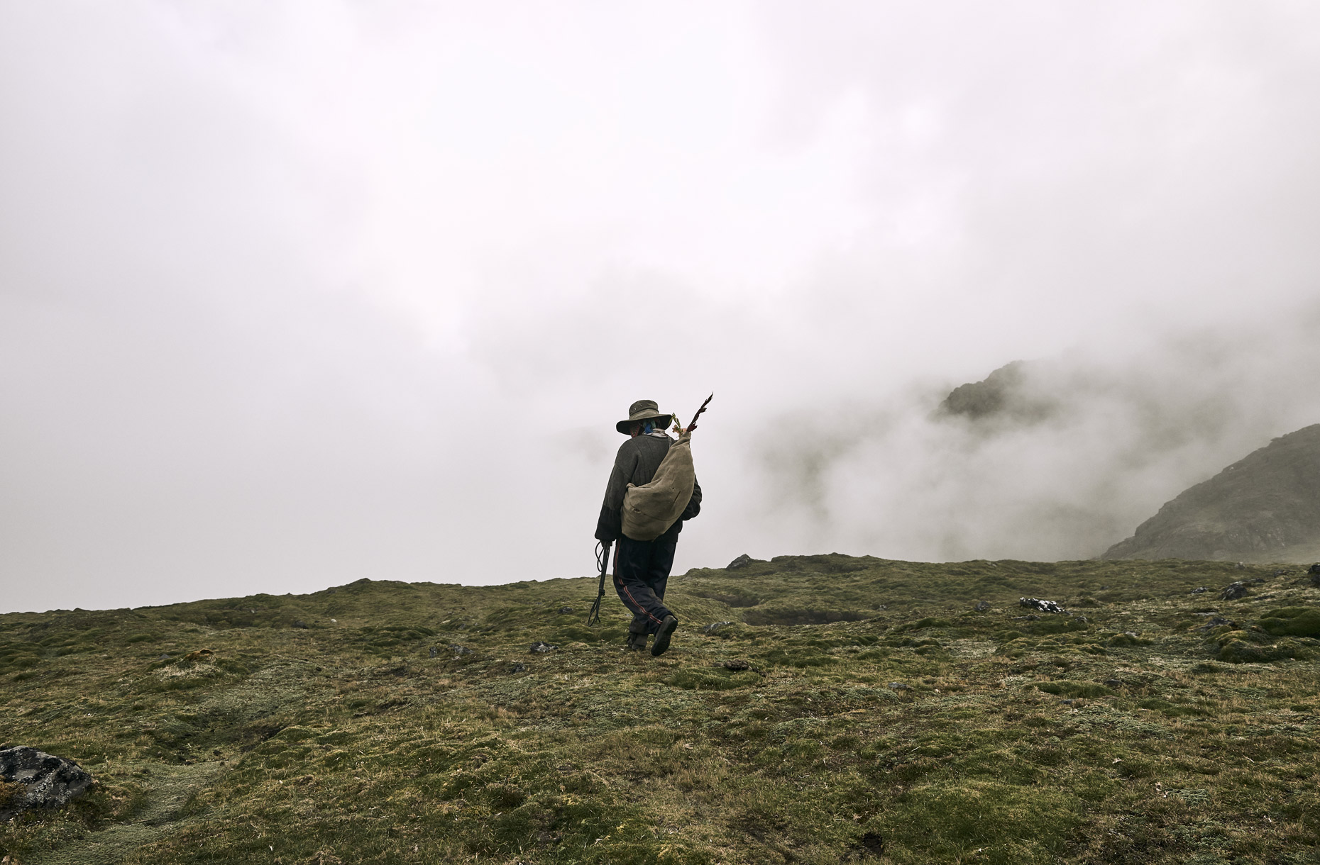 Peruvian-villager-hiking-into-the-distant-fog