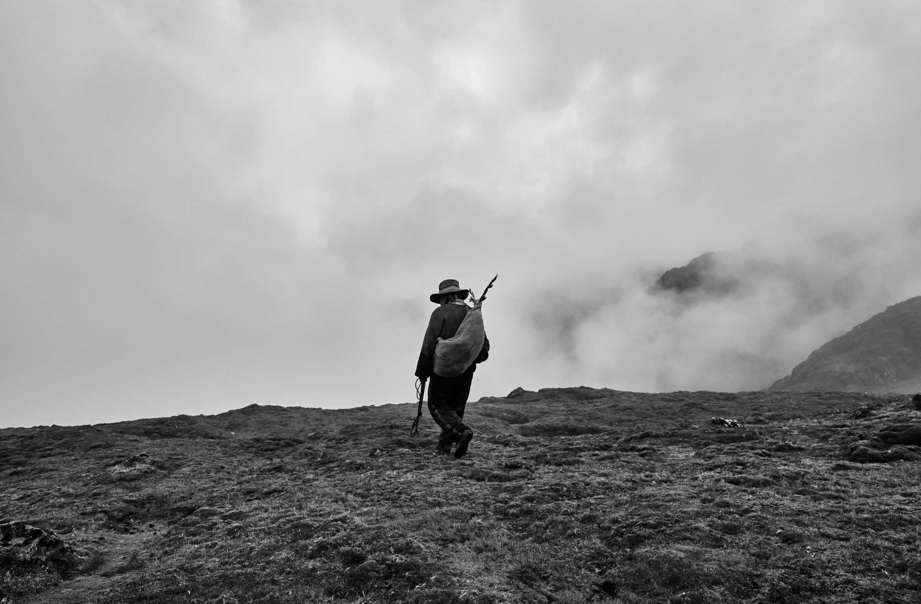 Peruvian-villager-hiking-into-the-fog