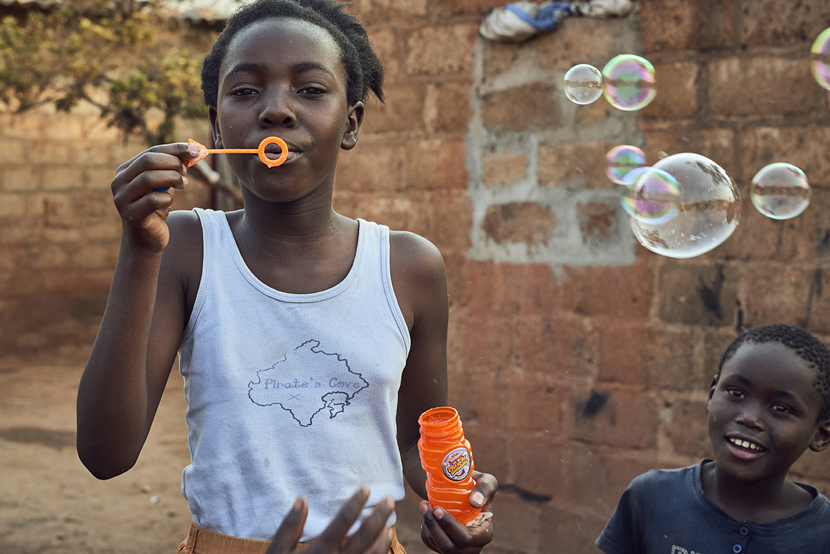 Playful-African-kids-blowing-bubbles