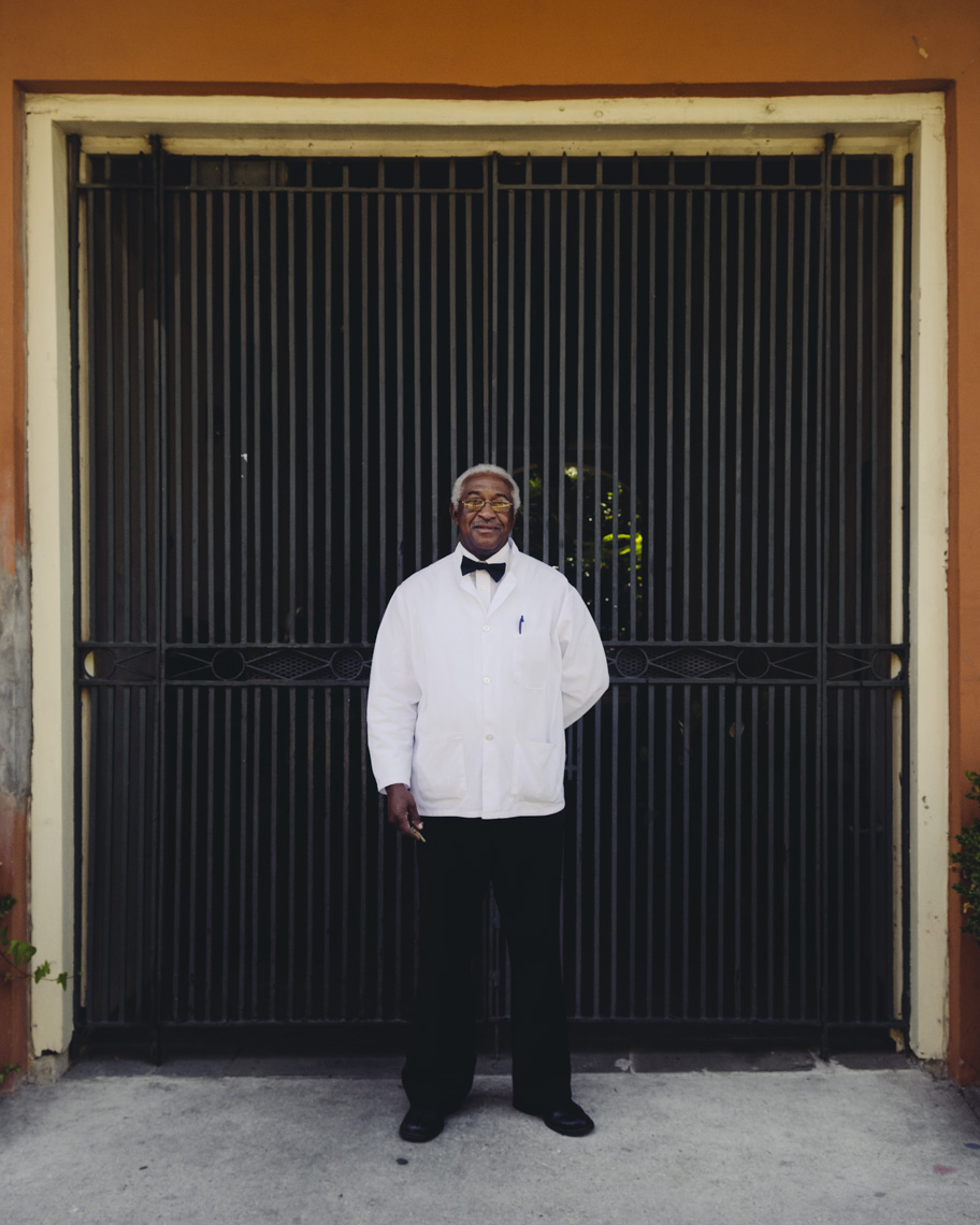 Portrait-of-an-African-American-bellhop-in-white-tuxedo