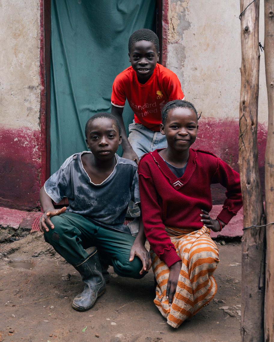 Portrait-of-three-kids-in-Africa-looking-at-camera-YES