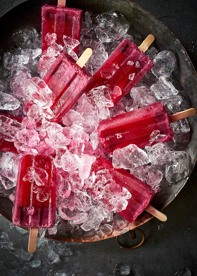 Red-Juice-Popsicles-in-Bucket-of-Ice
