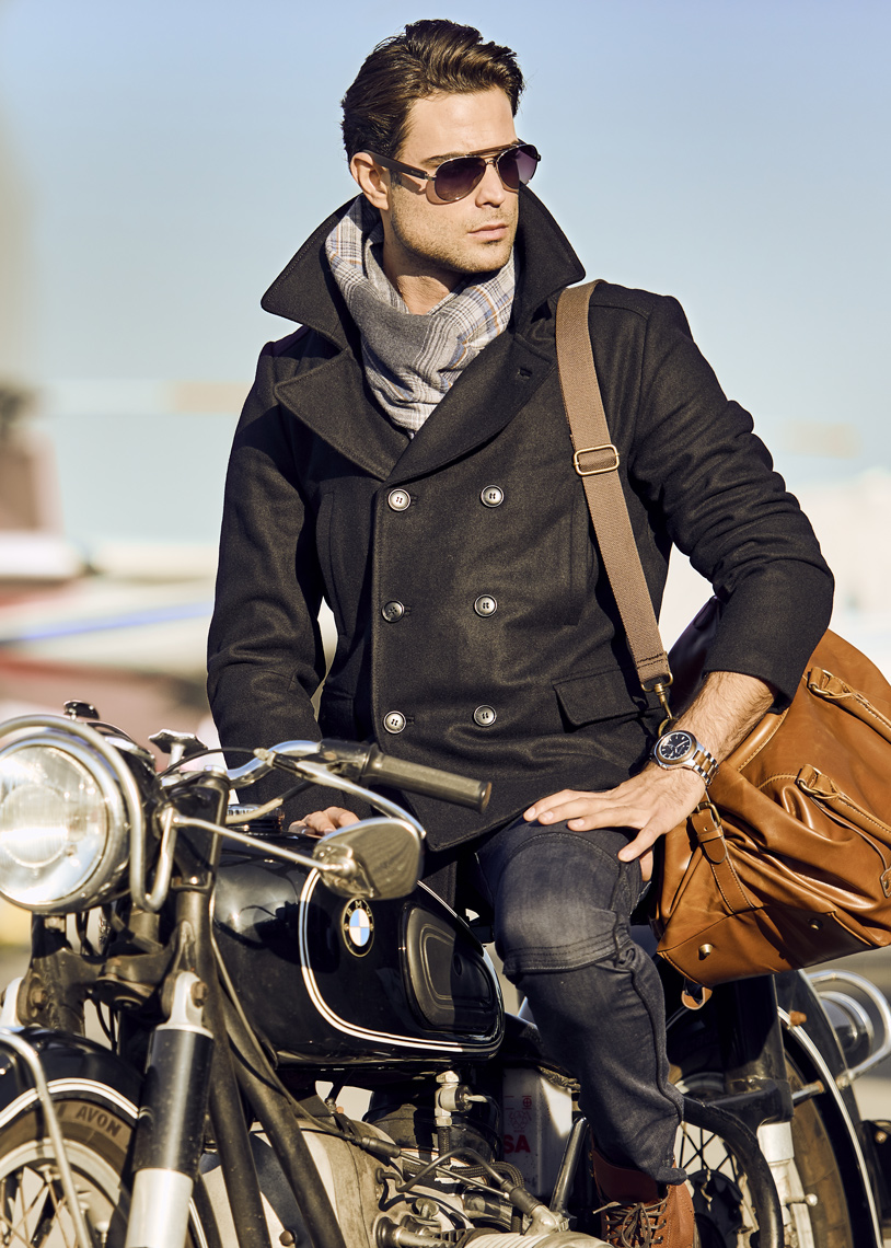 Silvano-Man-In-Jacket-Riding-Vintage-Motorcycle-With-Leather-Bag