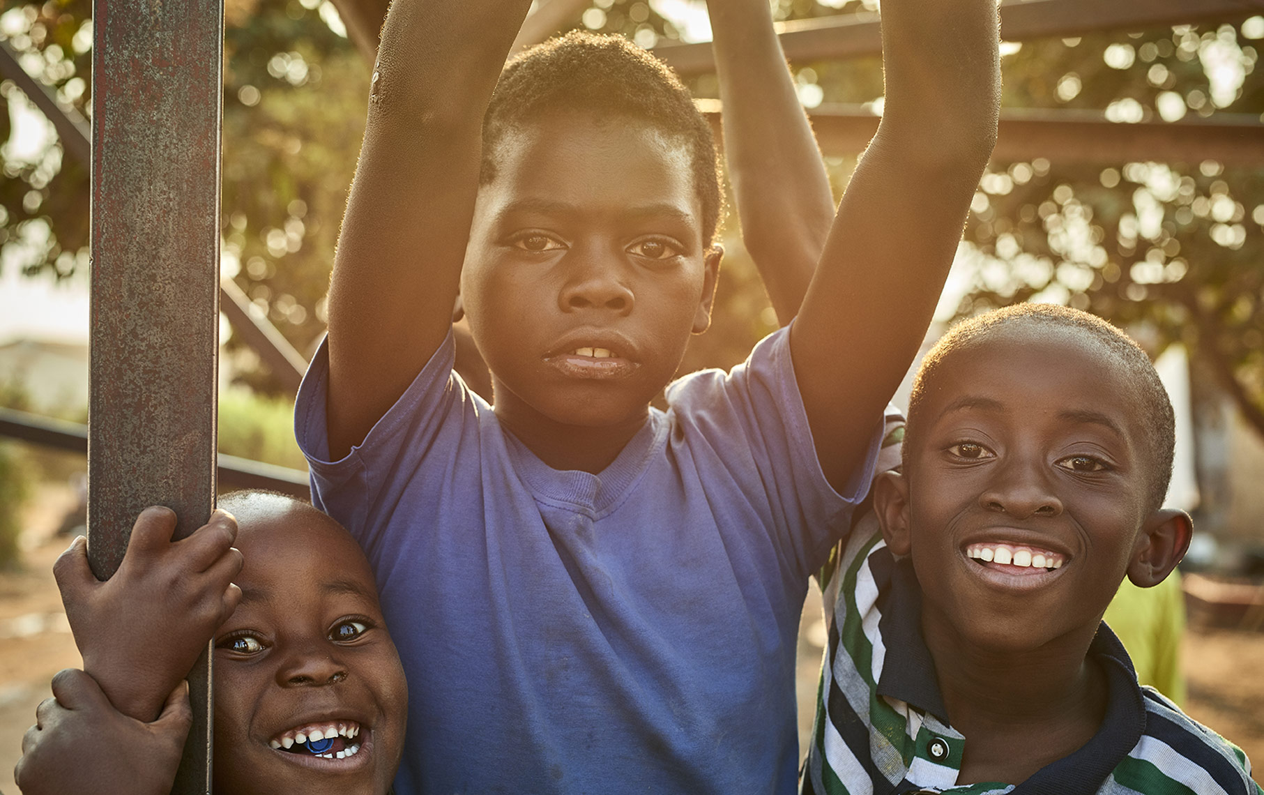 Three-cheerful-African-boys-posing